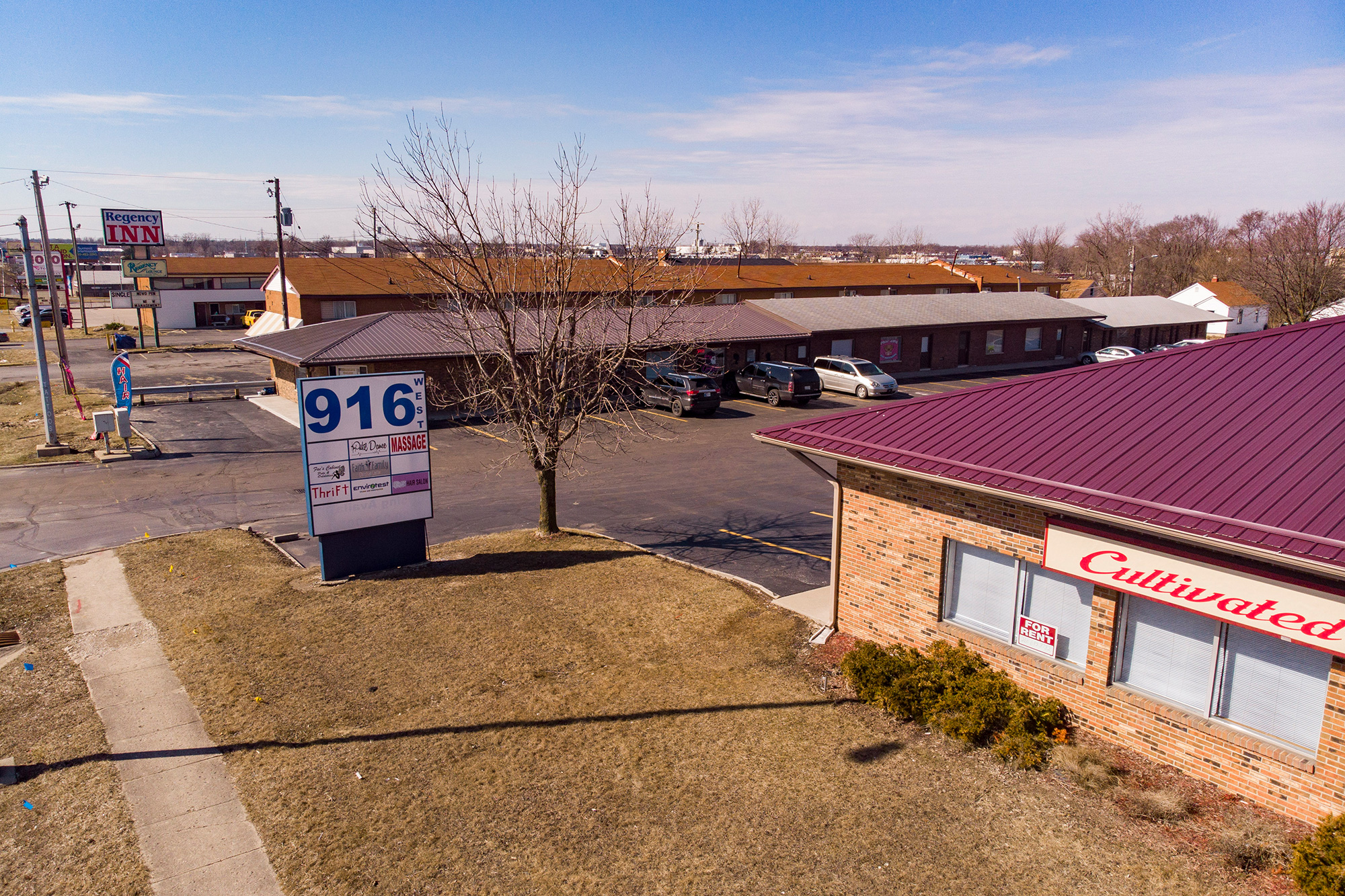 Two brick, 1 story, multi-tenant office/retail buildings for sale on busy Coliseum Boulevard