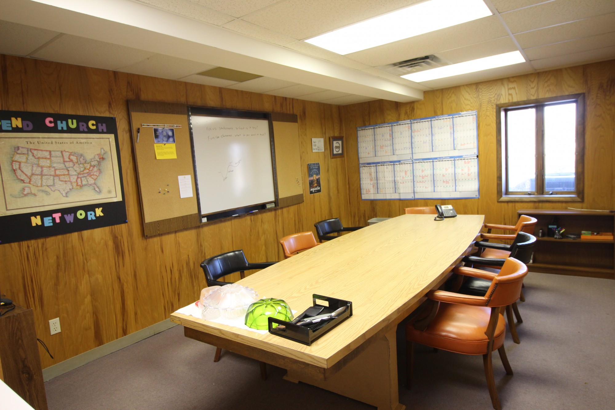 This is a meeting room with table.